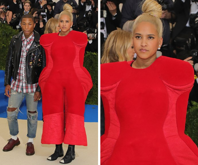 Red seems be the flavour of the night for fellow chair Pharrell and his wife, Helen Lasichanh.