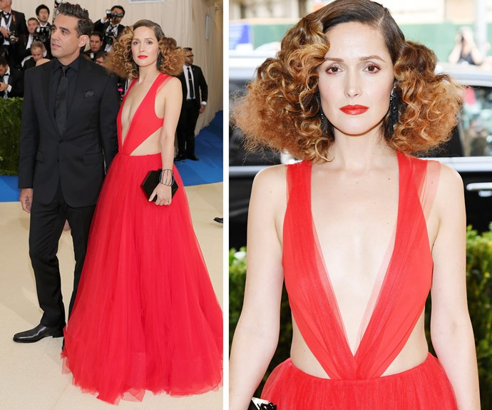 Homegrown hero Rose Byrne takes the plunge in this tulle creation and voluminous hair while her partner Bobby Cannavale rocks a dapper black tux.