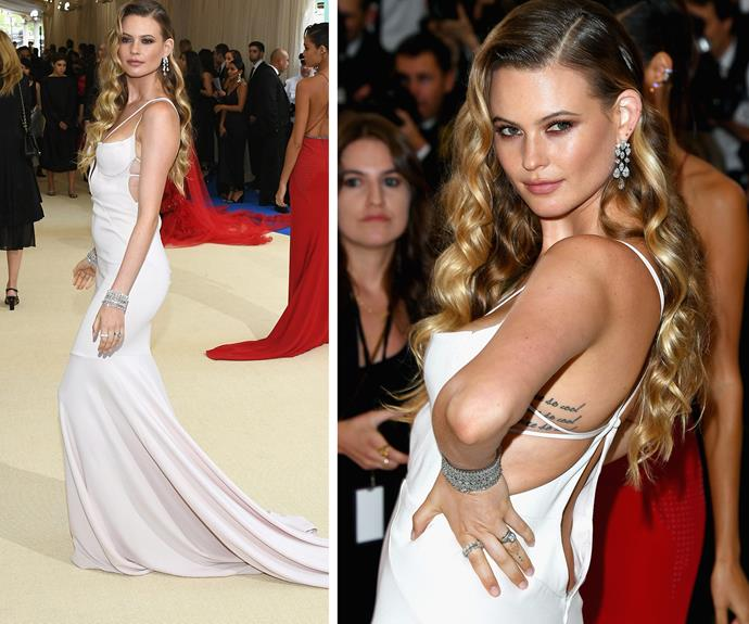 Behati Prinsloo, who welcomed daughter Dusty back in September, keeps things classic in this sexy white frock.