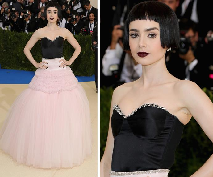 **WORST:** Lily Collins' dramatic bob and Giambattista Valli gown create an overly severe look on the *Rules Don't Apply* actress.