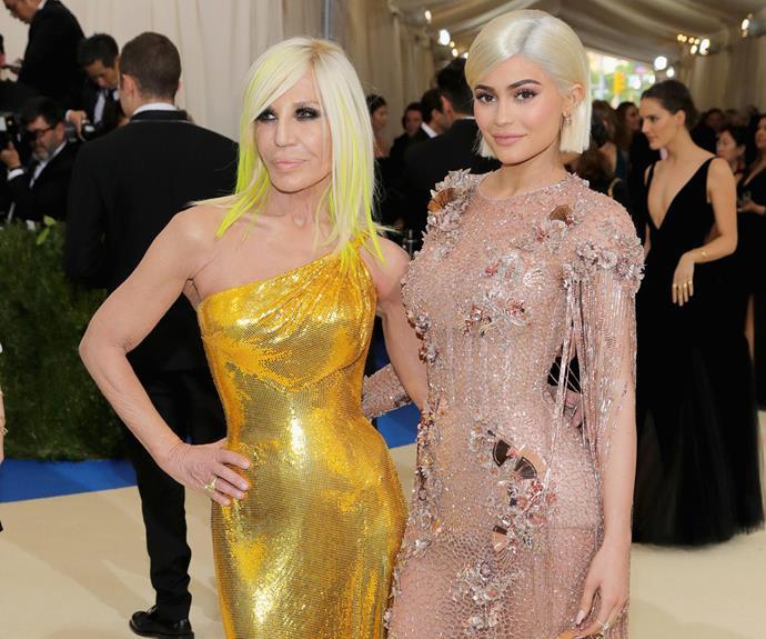The reality star strikes a pose with fashion designer Donatella Versace.