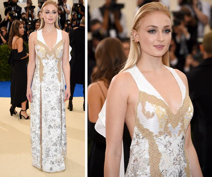 *Game of Thrones* star Sophie Turner opts for a gold and white ensemble.