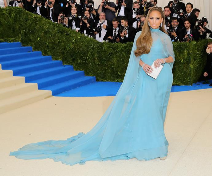 The 47-year-old has a princess moment as she walks the red carpet in this sweeping blue Valentino dress.