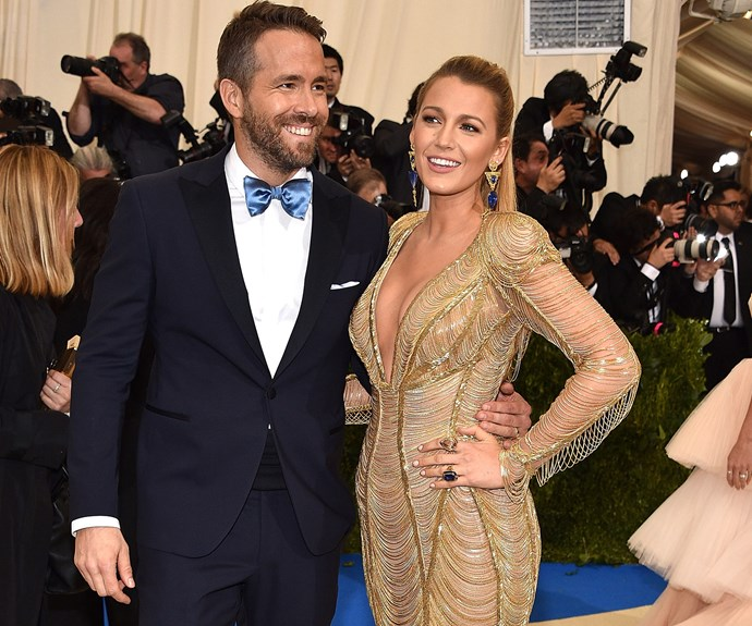 Blake and her main man, Ryan Reynolds! The *Deadpool* actor gives a subtle nod to his wife's outfit with his blue bow-tie.