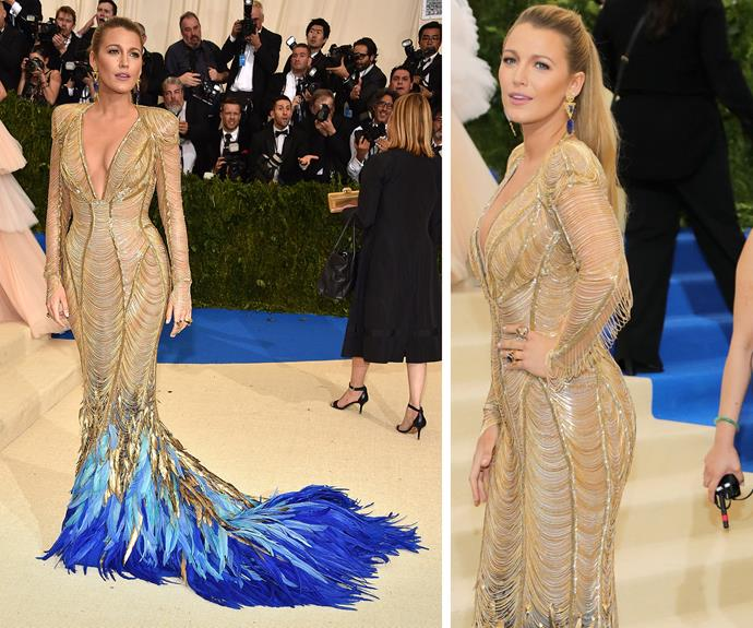 Blake Lively's gold gown has a very unexpected twist at the end - how cool are the blue feathers?