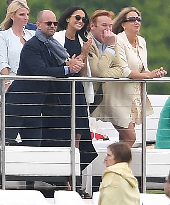 A proud Meghan watched on from the sidelines.
