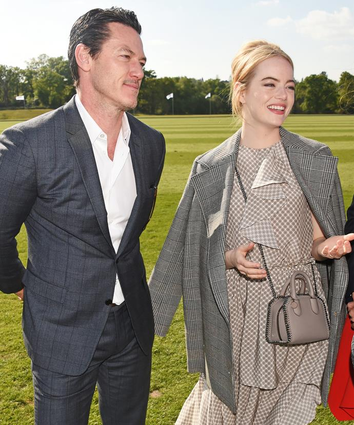 Luke Evans and Emma Stone take in the stunning event.