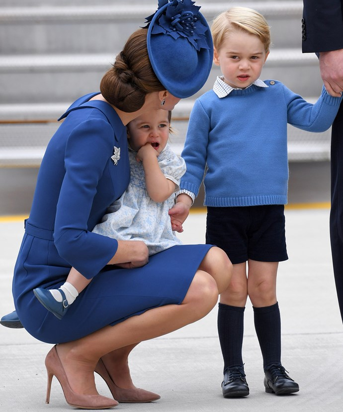 Taking a leaf out of her mother-in-law's book, Kate dressed George and Charlotte in navy hues as they touched down in Canada last year.
