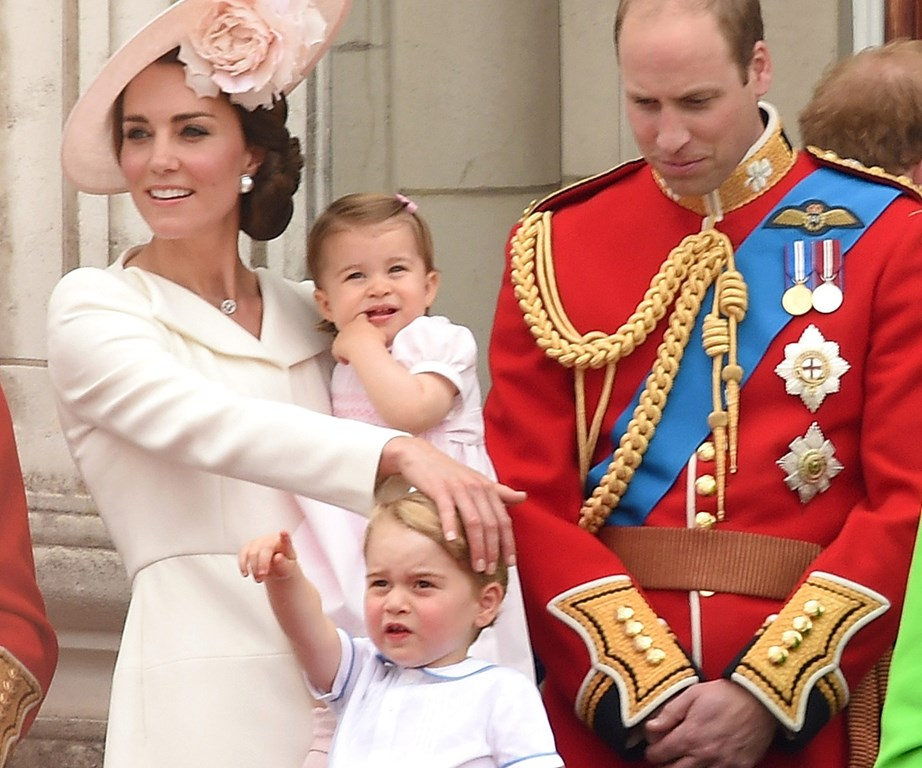 This time it's fourth-in-line to the throne Princess Charlotte who seems bored by the fanfare... Her big brother, in comparison, is completely into it.