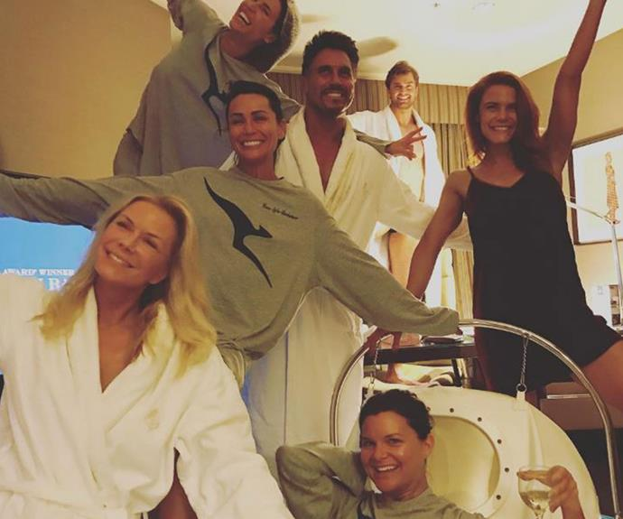 The cast all sported their robes and Qantas pjs for a 'spray tan party' at their hotel in preparation for a beach day.