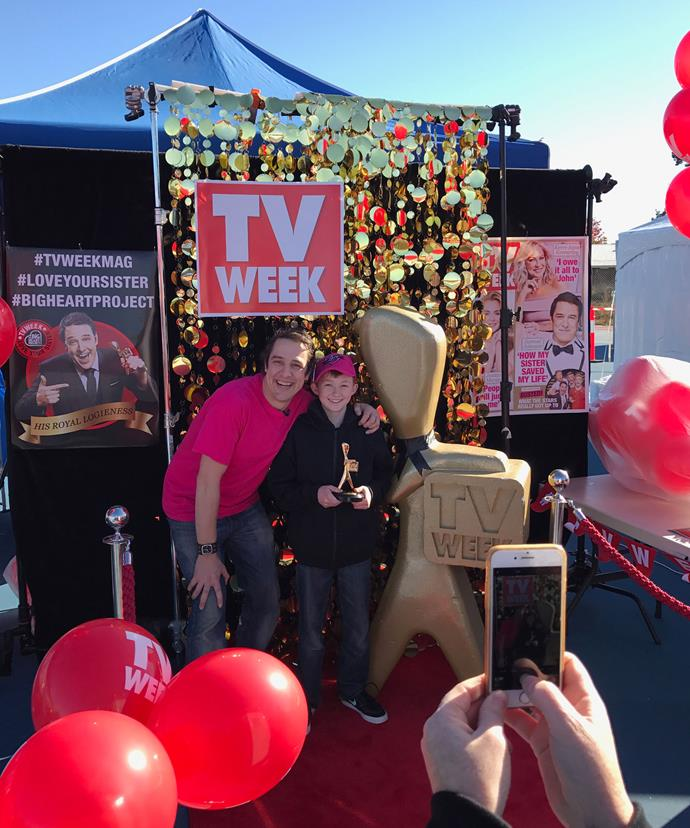 His Royal Logieness posing with a young fan at the TV WEEK photo booth!
