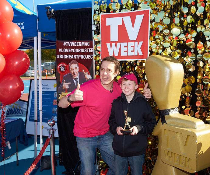 Sam posing with a young fan and his TV WEEK Gold Logie.