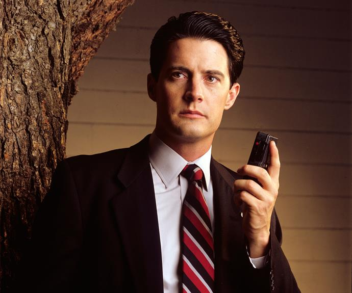 **Agent Dale Cooper:** He may appear like a straight-laced, suit-wearing FBI agent, but there is nothing normal about Dale Cooper (a career-best performance from Kyle MacLachlan). Constantly talking into a tape recorder, he uses unorthodox Tibetan dream techniques and throws stones at bottles to solve the death of Homecoming Queen Laura Palmer (Sheryl Lee). Despite his sunny demeanour and perky outlook on life, the all-American boy scout hides a dark past and a broken heart. It's these frailties, and an addiction to sugary highs and coffee rushes, that help him connect with the inhabitants of the Black Lodge.