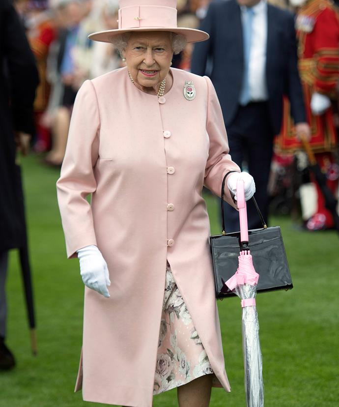 Her Majesty and her matching brolly.