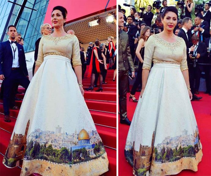 Israel's Minister of Culture and Sports, Miri Regev, walked the red carpet in what was *supposed* to be a dress she claimed celebrated the anniversary of the reunification and and liberation of Jerusalem, but ended up causing a political fire storm with some critics calling out the minister's casual approach to the Palestinian conflict. The dress features the skyline of Jerusalem with the Western Wall, the Tower of David and the Dome of the Rock.
