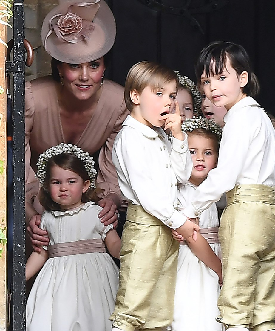 Duchess Catherine, staying away from the limelight, blending into the background on Pippa's big day.