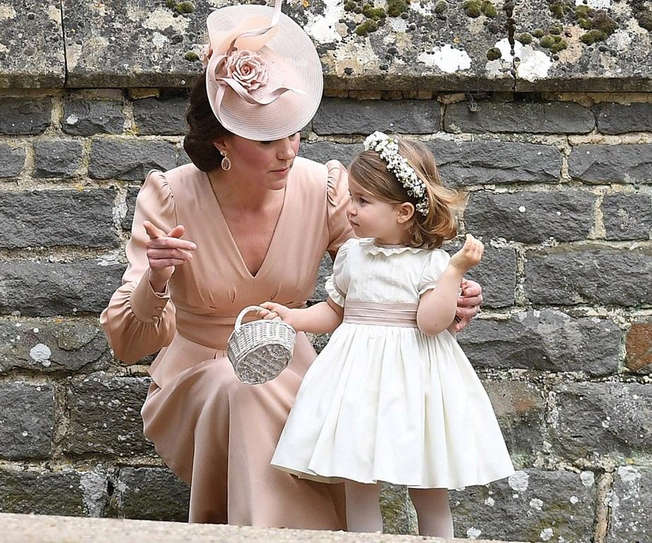 Duchess Catherine and Princess Charlotte at Pippa Middleton's wedding.