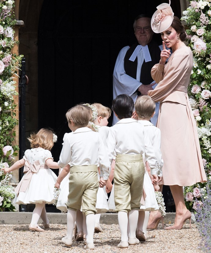 Kate leads the kids into the church while reminding them to keep quiet.
