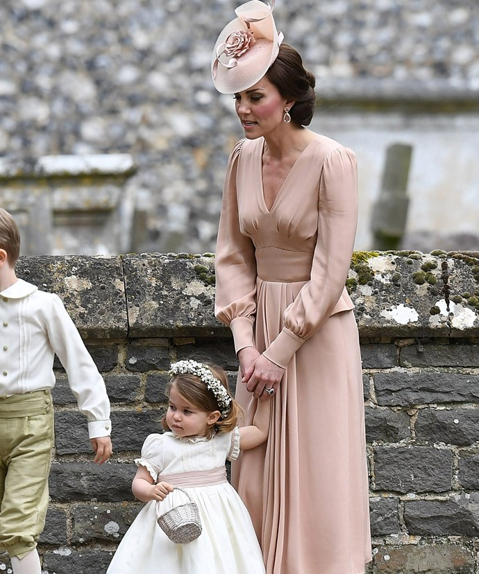 Catherine looked lovely in a blush-pink silk dress by Alexander McQueen.