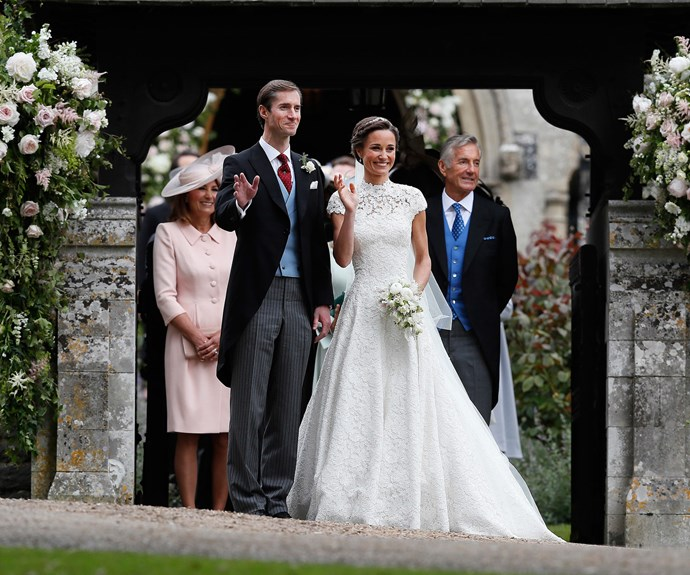 Flanked by her proud parents, Pippa waves to the crowd of well-wishers.