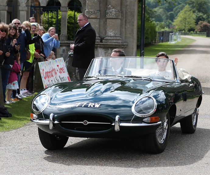Riding off into the future in an E-Type Jaguar.