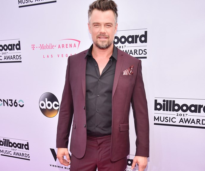 Josh Duhamel steps out sans wife **Fergie** in this maroon ensemble.