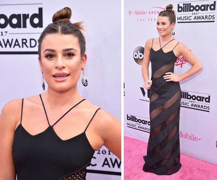 Lea Michele stuns in a sexy black cut-out dress and a high bun.