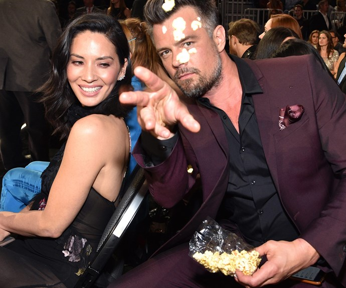 Josh Duhamel shows Olivia Munn what one does with popcorn at the Billboard.