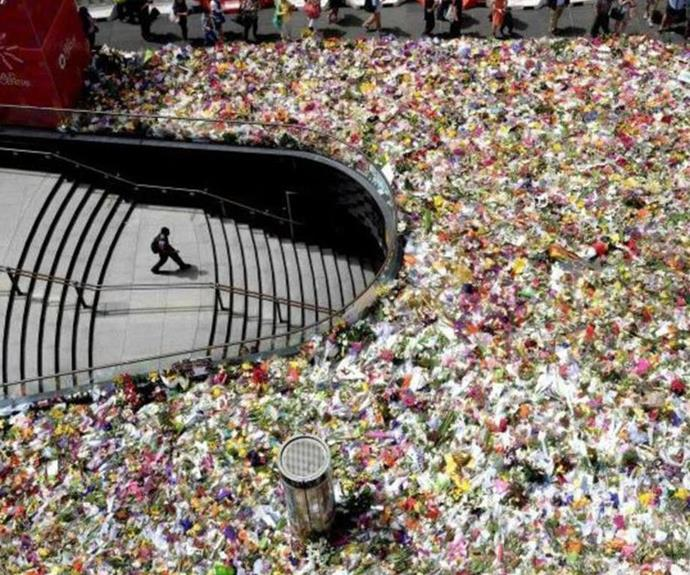 Flowers left at Sydney siege memorial.