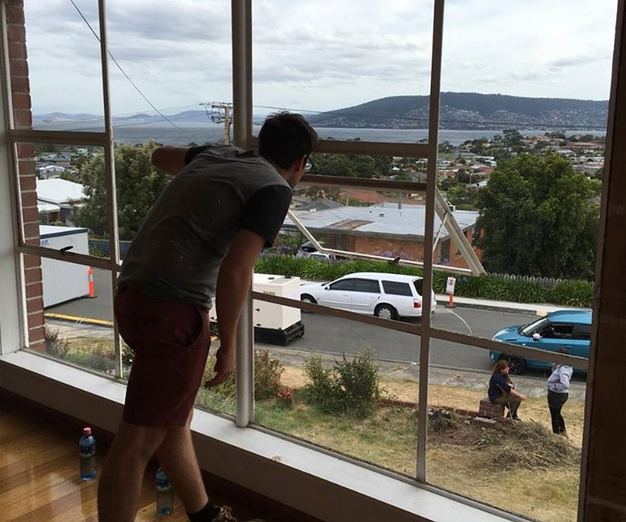 Andrew can't get enough of the view from Sean and Ella's Tassie home.