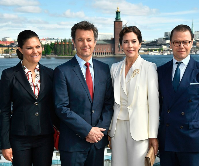 "This week, [Princess Mary](http://www.nowtolove.com.au/royals/international-royals/princess-mary-cant-be-friends-with-caroline-fleming-37419|target=""_blank"") and Prince Frederik (centre) are visiting Prince Daniel and Princess Victoria of Sweden. Here the group pose before attending a seminar in in Stockholm, Sweden."