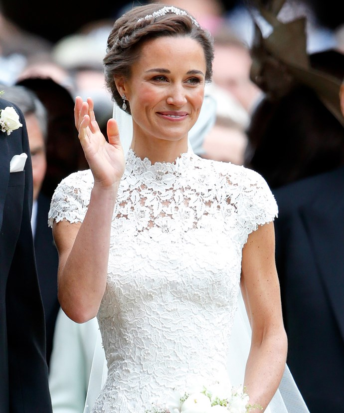 Pippa is a vision in her beautifully elegant lace wedding dress.