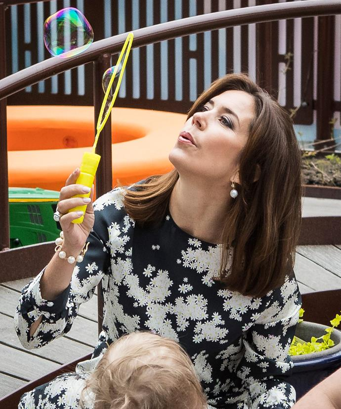Princess Mary shows off her secret bubble-blowing talents as she visits the New Karolinska Solna University Hospital in Stockholm.