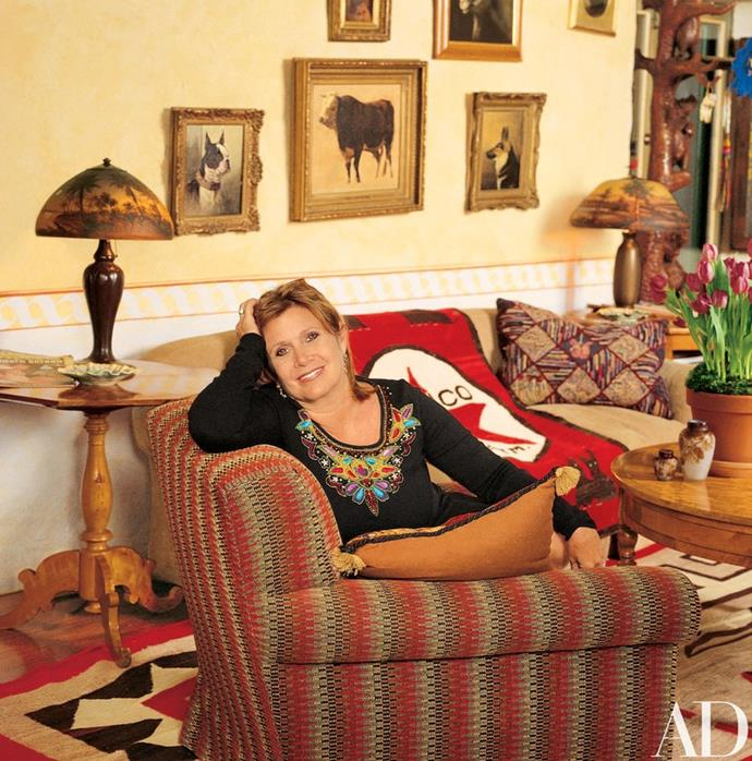 Carrie in her living room, from *Architectural Digest*.
