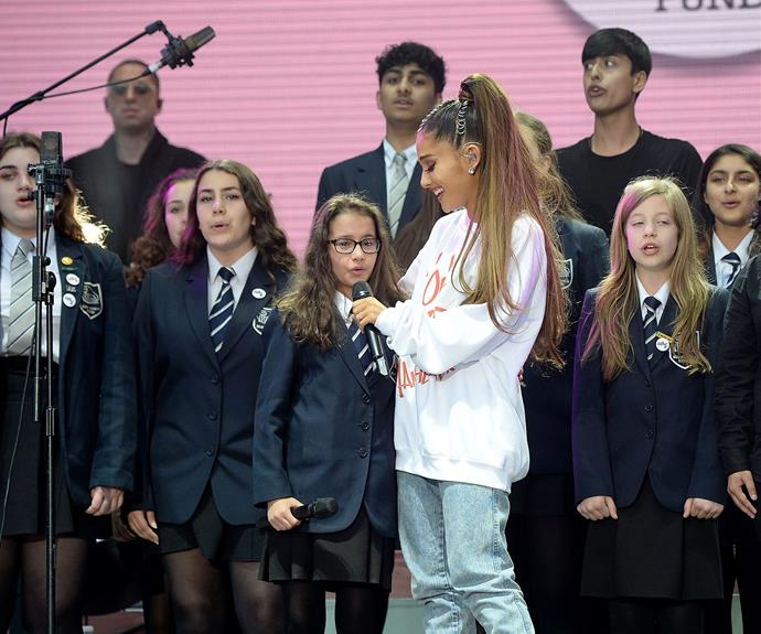Ariana was joined by a local choir.