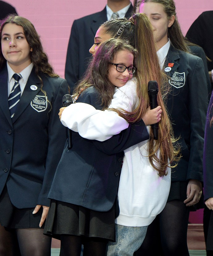 The singer shares a cuddle with her young fan, 12-year-old soloist Natasha Seth.