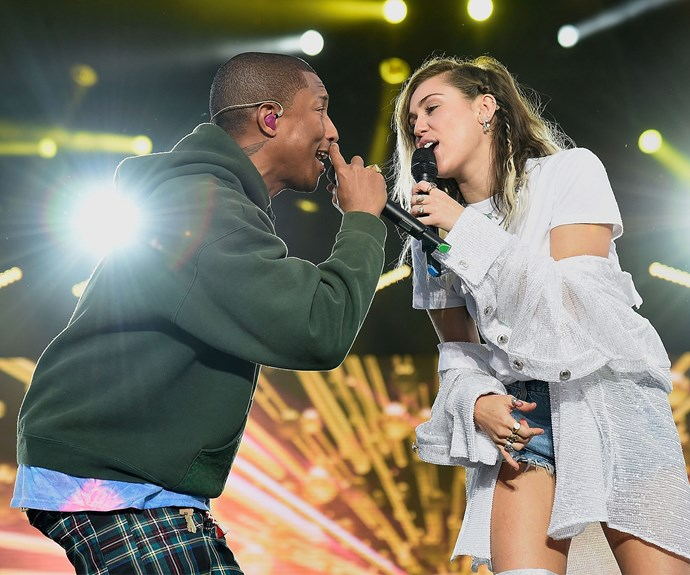 Miley belts out a tune with Pharrell.