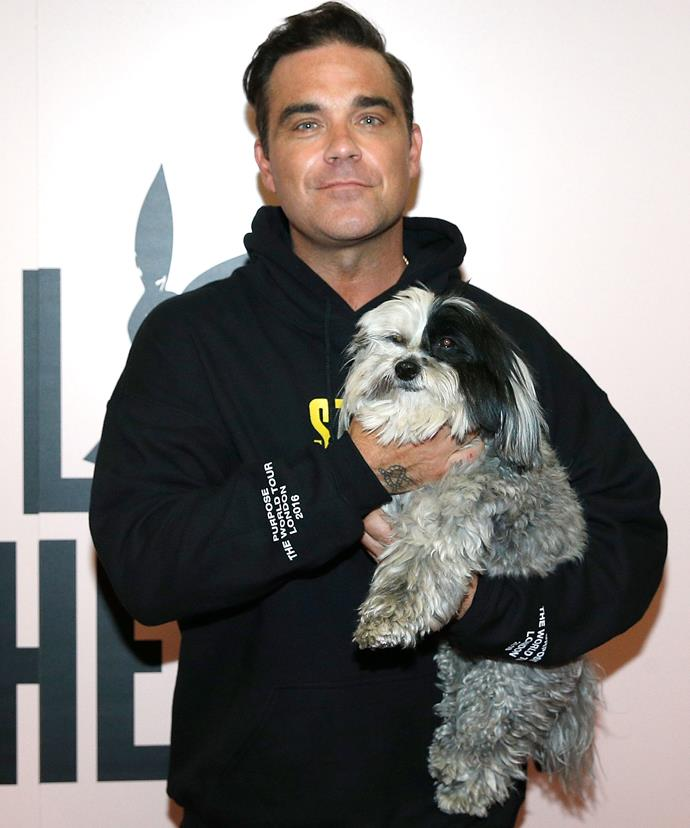 Robbie Williams is supported by a fury friend.