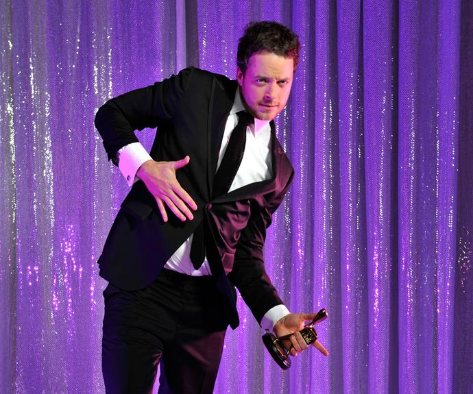 Hamish Blake busting a move with his TV WEEK Logie.