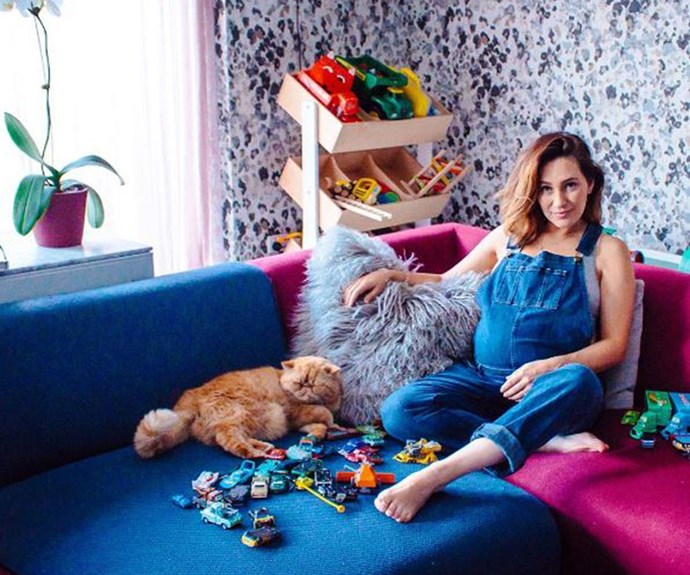 "While preparing for the imminent arrival of her new bubba, Zoë took a break from winning social media to get some pregnancy snaps taken by photographer Mrs White, surrounded by all her ""favourite toys"" and of course, her beloved cat Meowbert. ""When I demanded a Dior gown, a golden pond and a dozen ballerinas for my pregnancy portrait, Mario Testino said it'd be fine. But then my mate @mrswhitephotos said SHE'D do it, AND I could have all my favourite toys in the photo. Sulaaamm dunk,"" Zoë joked. Nice work, Zo."