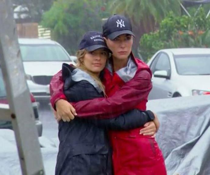 Ella and Kate embrace as Cyclone Debbie wrecks havoc on Daniella and Aaron's Gold Coast home.