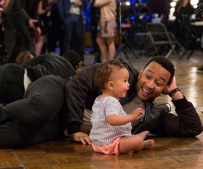 [Chrissy Teigen](http://www.nowtolove.com.au/parenting/parenting-news/chrissy-teigen-baby-child-adoption-38290) snapped this beautiful shot of her husband **John Legend** sharing a laugh with the couple's daughter, Luna, who turned one in April.