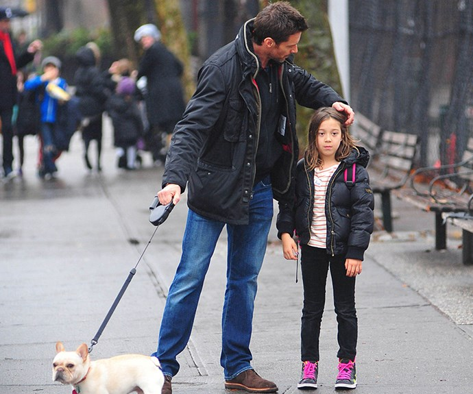Dad On Duty: Wolverine star **Hugh Jackman** plays hairdresser to 11-year-old daughter Ava while the pair enjoy a stroll in New York.