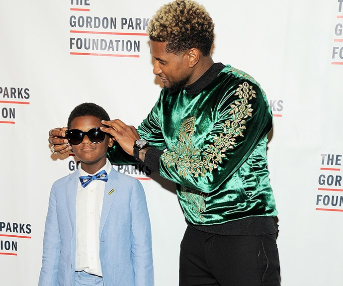 Proving cool runs in the family, **Usher** and his eight-year-old son, Naviyd Ely Raymond, enjoy a night out at a charity event, sharing jokes, poses and accessories on the red carpet.