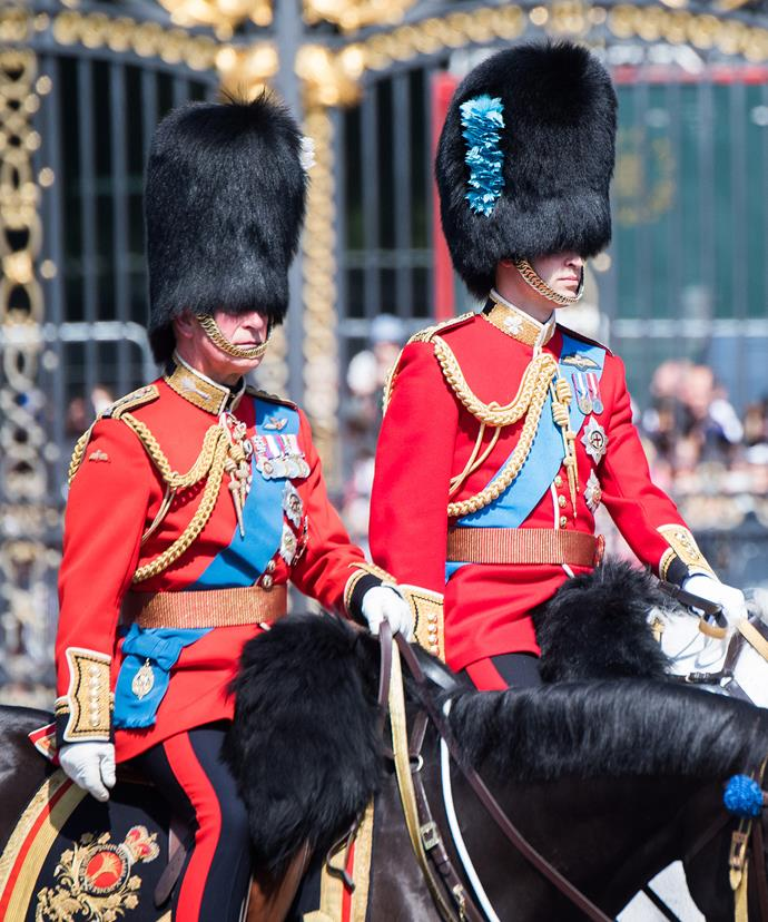 It's a father-son act! Prince Charles and Prince William on horseback.