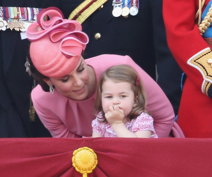 Charlotte's locks were pinned back with a tiny maroon bow.