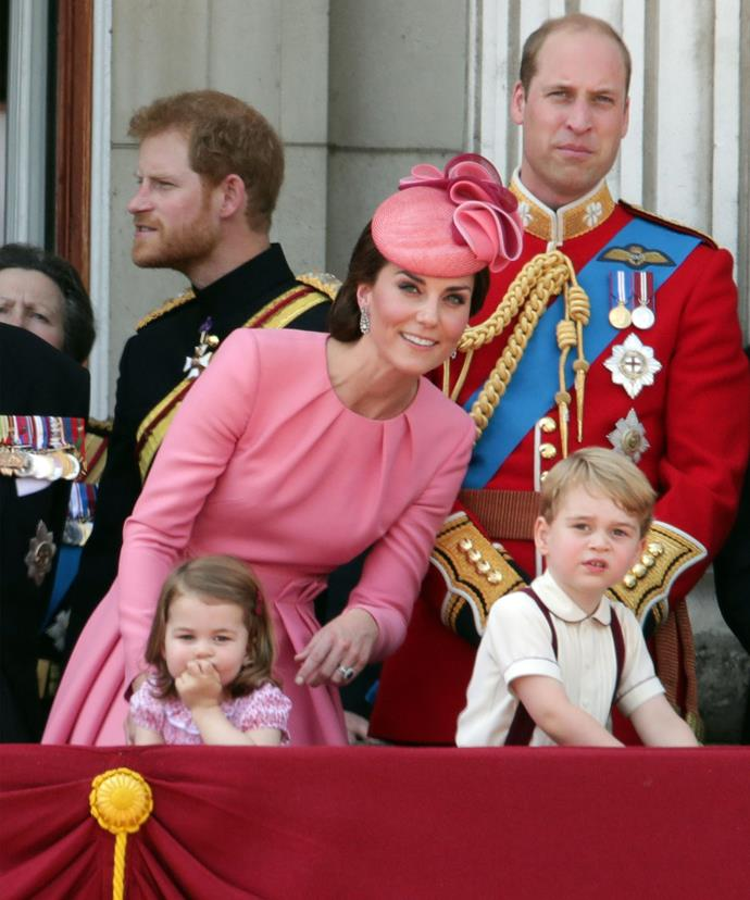 Uncle Harry stands behind the Cambridges.