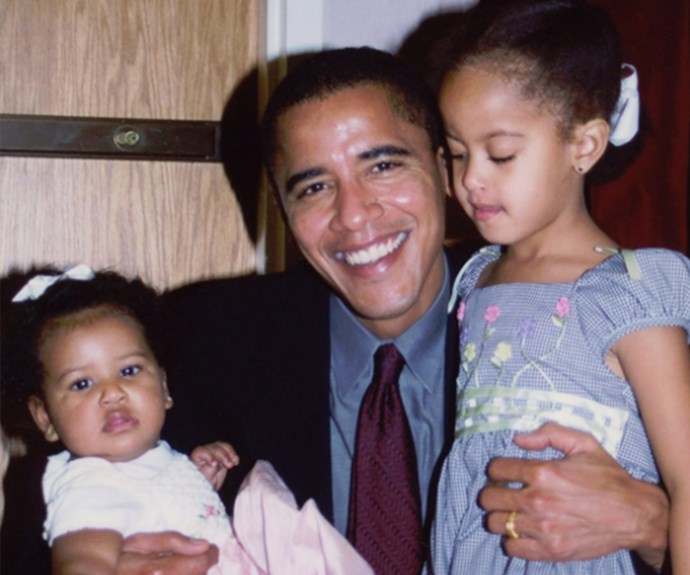 """Our daughters may be older and taller now, but they'll always be your little girls. We love you,"" Michelle Obama penned to husband Barack alongside this too-cute-for-words memory."