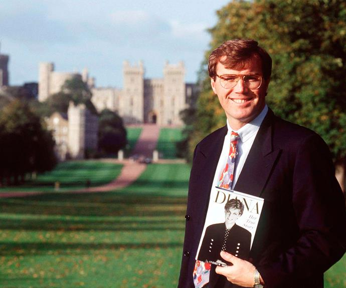 Then: Author Andrew Morton holds up a copy of *Diana, Her True Story*, outside Windsor Castle in 1994.