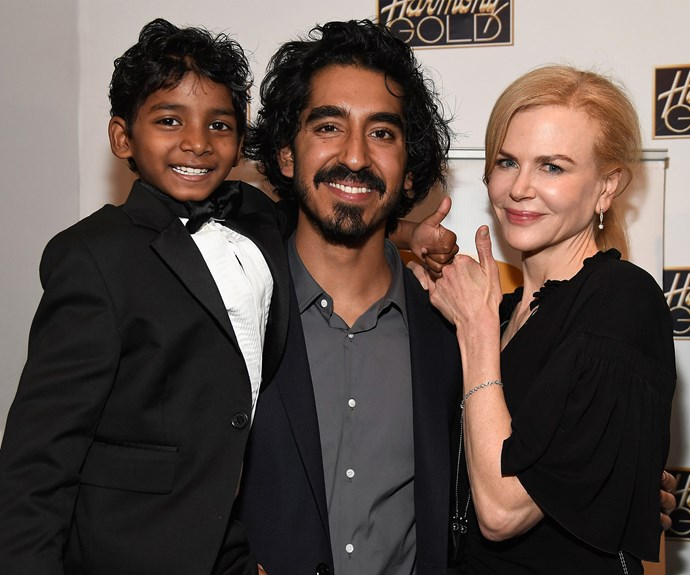 The actress cuddles up with her *Lion* co-stars, Sunny Pawar and Dev Patel.